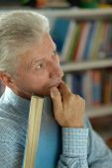 Retired man reading book — Stock Photo