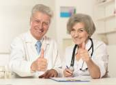 Senior doctors snow thumbs up — Stock Photo