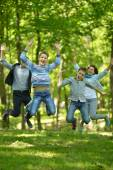 Family jumping in park — Stock Photo