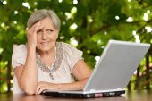 Middle-aged   with laptop — Stock Photo