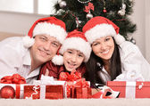 Family with christmas gifts — Stock Photo