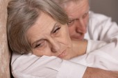 Sad elder couple at home — Stock Photo