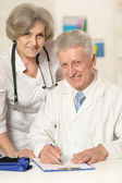 Portrait of two senior doctors — Stock Photo