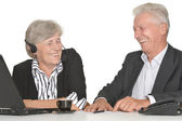 Two elderly people working — Stock Photo