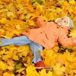 Little girl in an autumn park — Stock Photo #62955513