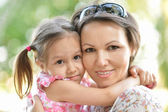 Mother with daughter  in summer — Stock Photo