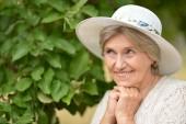 Happy elderly woman in  hat — Стоковое фото