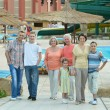 Family relaxing at vacation resort — Stock Photo #65062565