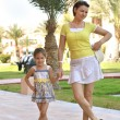 Mother with daughter  in park — Stock Photo #65062979