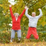 Senior couple exercising in park — Stock Photo #65065447