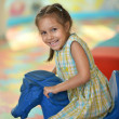 Little girl with fairground horse — Stock Photo #65065549