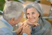 Senior couple sitting at  table — Foto de Stock