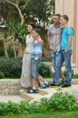 Family in tropical ressort — Stock Photo