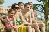 Family having fun near pool — Stock Photo