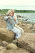 Senior couple near the water — Stock Photo