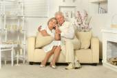 Elderly people sitting at home — Stock Photo