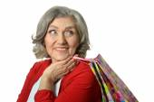 Senior woman with shopping bags — Stock Photo