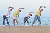 Happy family doing  exercises — Stock Photo