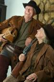 Hunters in western clothes — Stock Photo