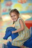 Little girl with fairground horse — Stock Photo