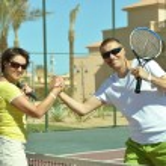 Tennis players standing near net — Stock Photo #68346699