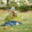 Mom with kids in park — Stock Photo #68347795