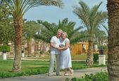 Senior couple  at tropic hotel garden — Stock Photo