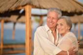 Mature couple on beach — Stock Photo
