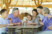 Happy family at breakfast — Stock Photo