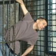 Man in metal cage — Stock Photo #68923159