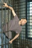 Man in metal cage — Stock Photo