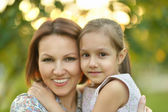 Girl with mother in park — Stock Photo