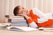 Nice boy does homework — Stock Photo