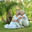Couple sitting on grass — Stock Photo #69288259