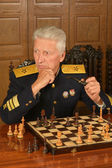 Mature general playing chess — Stock Photo