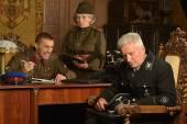 Soviet soldiers interrogating hostage — Stock Photo