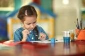Little girl drawing at home — Stock Photo