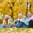 Family relaxing in autumn park — Stock Photo #69604725