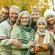 Family relaxing in autumn park — Stock Photo #69604913