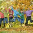 Family relaxing in autumn park — Stock Photo #69605457