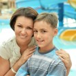Happy mother and son near pool — Stock Photo #69606111