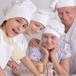 Happy family cooking together — Stock Photo #70242203