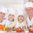 Happy family cooking together — Stock Photo #70243245