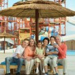 Family relaxing at vacation resort — Stock Photo #70973677