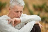 Sad senior man outdoors — Stock Photo