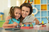 Girl painting with  mother — Stock Photo