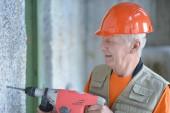 Senior Man at  construction work — Stock Photo