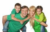 Familjen i en grön kläder — Stockfoto