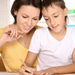 Mother and son  drawing together — Stock Photo #71477681