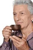 Senior man met kopje koffie — Stockfoto